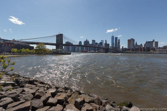 Real estate photographer work views of the manhattan bridge and the manhattan skyline from the brooklyn waterfront