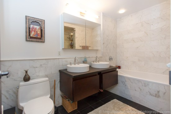 Recently renovated bathroom midtown west apartment photography new york