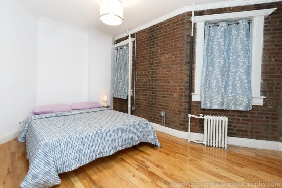 Master bedroom of Soho three bedroom apartment in Manhattan, New York City