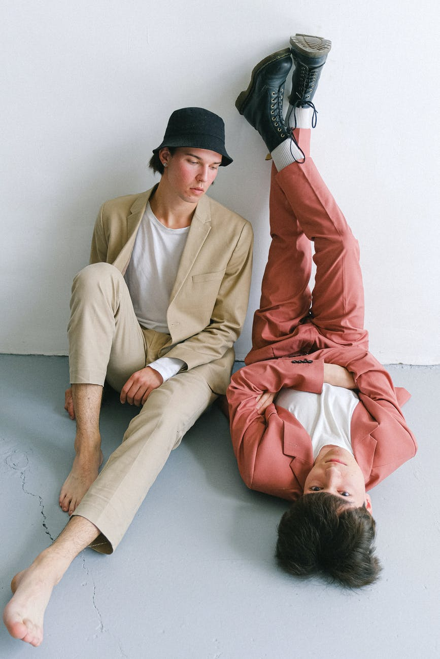 two men in suits posing
