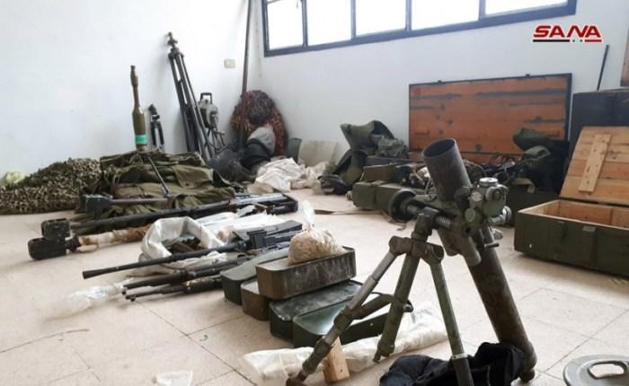 أسلحة بينها صواريخ إسرائيلية الصنع من مخلفات الإرهابيين غرب مدينة نوى بدرعا
