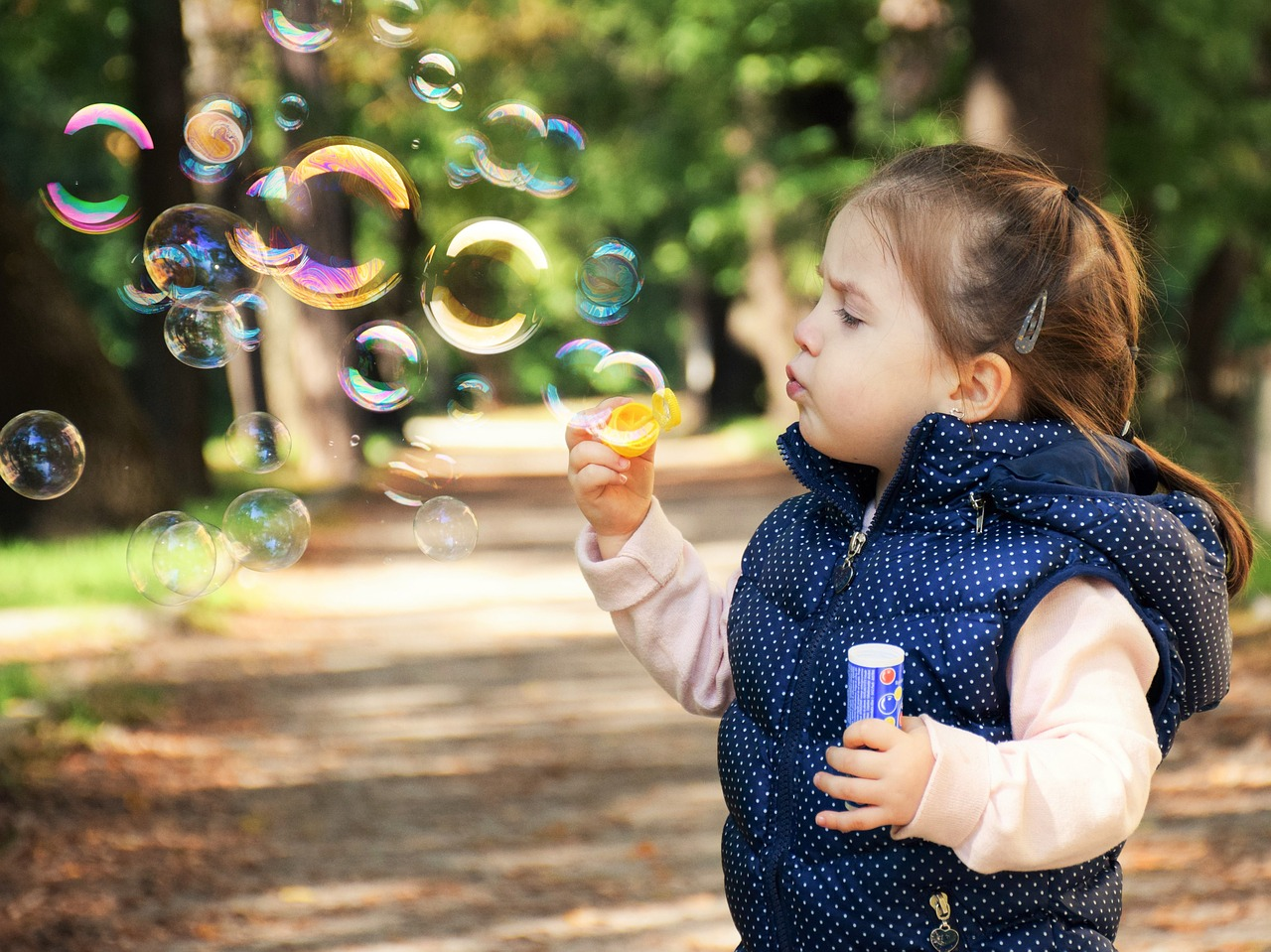 Little girl blowing bubble