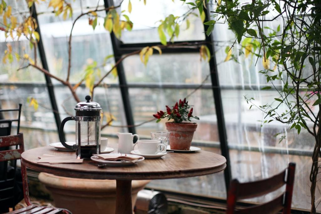 Relaxing table and chairs with cup of coffee in New York City on a rainy day