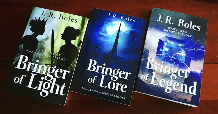 Alt text: photo of complete trilogy, BRINGER OF LIGHT, BRINGER OF LORE, and BRINGER OF LEGEND.