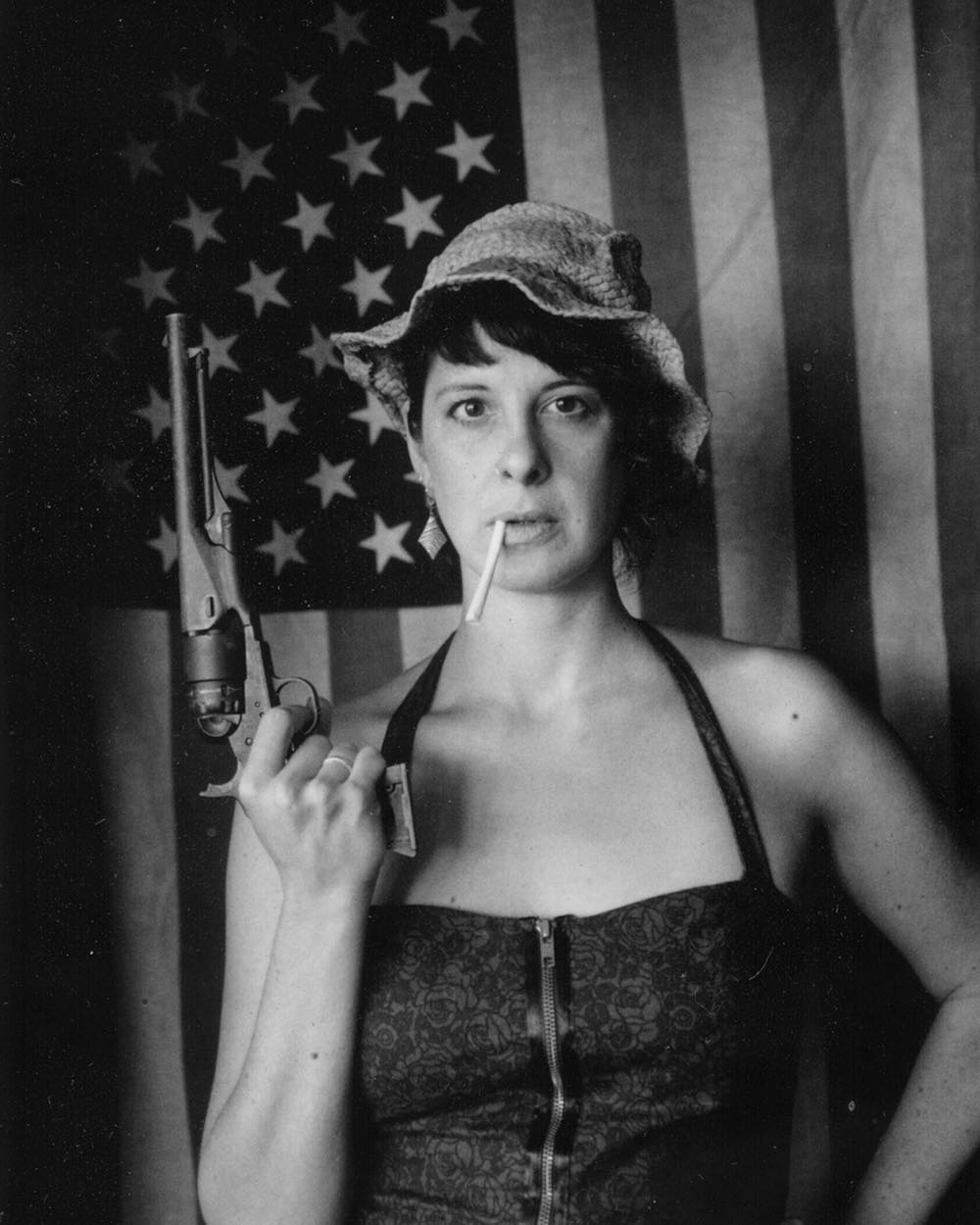 Kimberly with gun and flag.