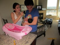 Mommy documenting baby E's 1st bath