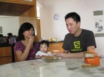 3 generations enjoying cake together
