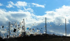 Wind holding up trash at a landfill