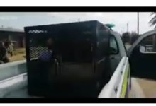 News24.com | Probe launched into video of man locked in dog cage inside a police van