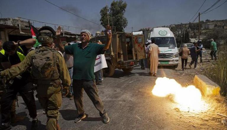 Dozens of Palestinian protesters injured in clashes with Israeli soldiers: Medics
