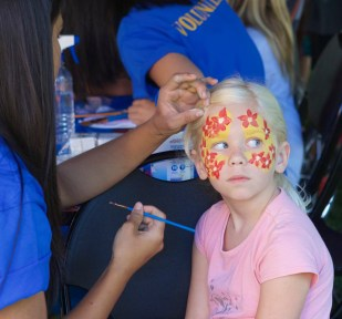 Brooklyn McLeod, an 8-year-old Gaston resident, gets her face painted at a National Night Out event in Forest Grove, Oregon. More than 16,000 communities in the U.S., its territories, Canada and worldwide military bases hold National Night Out events on the first Tuesday of August, according to the National Association of Town Watch.