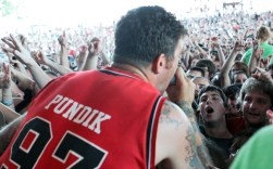 Jordan Pundik, lead vocalist of rock band New Found Glory, sings and interacts with fans during a Warped Tour stop at Riverbend Music Center in Cincinnati.