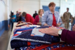 More than 40 Quilts of Valor were awarded to Oregon Army National Guardsmen at the Hillsboro Armory in Hillsboro, Oregon on Sept. 27, 2015. Portland-based quilting group Northwest Quilters has been making Quilts of Valor since 2004 and awarded 72 of them in its last fiscal year. The Quilts of Valor Foundation is a nonprofit that awards quilts to service members and veterans.