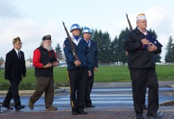 Larry Tomb, a 68-year-old Hillsboro resident and Air Force veteran, prepares to post the colors. Tomb served from 1965 to 1987 and rose to the rank of master sergeant. About 150 people attended a Veterans Day ceremony on Nov. 11, 2015 at the Washington County Veterans Memorial in Hillsboro, Oregon.