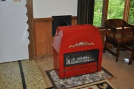 This Belgian made wood burning stove could heat the whole house, but is an eyesore in a modern kitchen. We removed but kept it in case of apocalypse.