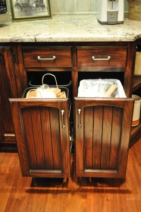 These cabinets were moved from one side of the kitchen to the other and converted to trash and recycling bins.
