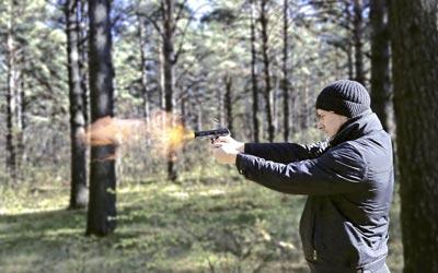 Man shooting gun made with 80 lower receiver jig