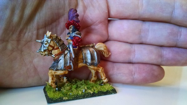 Hand Painted Miniature Mounted Swordsman, with hand for scale. Click to Enlarge.