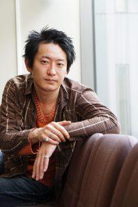 headshot of a Japanese theatre director Kenichi Tani