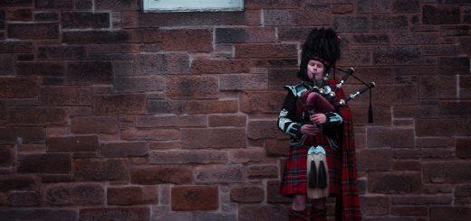 A man playing bagpipes in Edinburgh