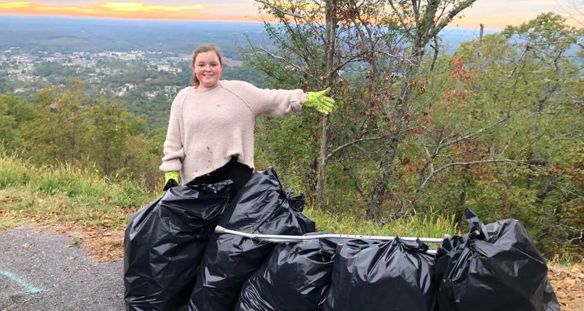 Kaylee Jeter, pictured above, and her mother, Christine Brasher, spent a Friday afternoon collecting trash at the popular Jacksonville site, Chimney Peak Mountain. (Courtesy of Christine Brasher)