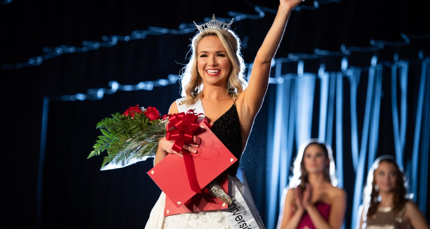 Camden Swatts, pictured, waving to the crowd after crowned the 38th Miss Jacksonville State University. (Grace Cockrell/JSU)