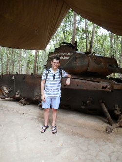 Me standing next to an American tank that was destroyed by a Viet Cong mine in 1970.
