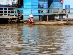 Cambodian woman in boat on Tonlé Sap lake