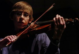 Editorial - Young violinist performs a solo.