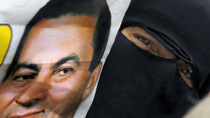 The good old days?: An Egyptian woman holds a poster of ousted President Hosni Mubarak during a demonstration outside the Supreme Administrative Court in Cairo on Monday.  The court says it does not have jurisdiction to rule on a case launched by supporters of Mubarak who challenged the legality of his removal from power two years ago.