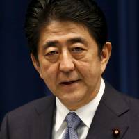 Under pressure: Prime Minister Shinzo Abe is seen delivering a statement on the anniversary of the end of World War II on Aug. 14. Abe's misfortunes — from opposition to his defense guidelines to his health — have been the topic of heavy coverage in Japan's weekly magazines this month. | REUTERS