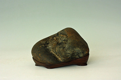 "Base by Mas Nakajima - 2008; W 7"" x D 6"" x H 5""; Klamath river stone on walnut base"