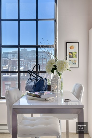Table, accessories, books and window