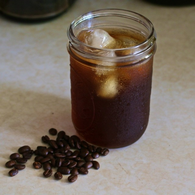 A mason jar full of cold brew coffee