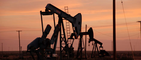 Inventories drop, oil prices kiss $70 a barrel