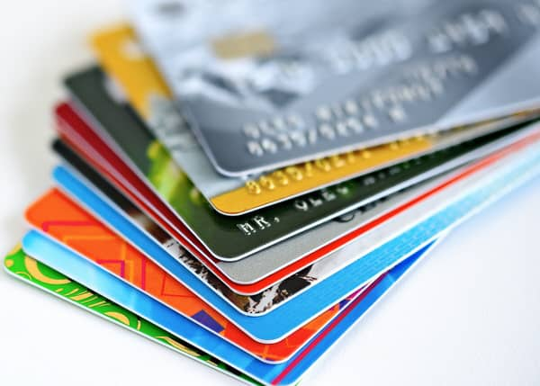 independence with a prepaid debit card+stack-of-credit-cards