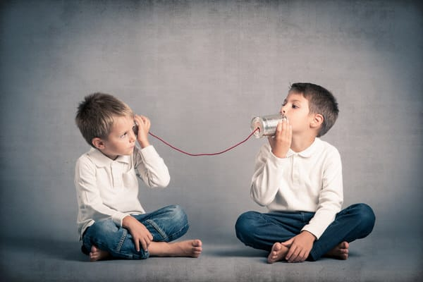 Sibling friction over elder care+boys-tin-can-phones