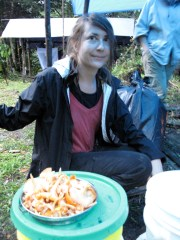 Dr. Cathie Aime prepares to feast on wild chantrelles (Canthaerellus guyanensis) at the long term research site, Potarro River Basin, region 8, Guyana