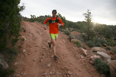 The rising sun peeks through clouds looming in the sky above as a runner makes his way along the Flying Monkey Trail above Virgin early Friday, April 8, 2016 during the Zion 100 ultra marathon trail race. Runners competing in the 100K and 100 mile distances left the starting line Friday morning while runners competing in 55K and half-marathon distances will start Saturday morning. Despite a high probability of rain over the weekend, nearly 300 runners took of from the starting line Friday morning and more than another 200 were expected to run Saturday.