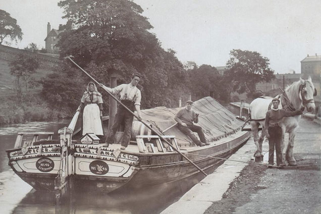The narrowboats were designed at the maximum size to fit in the smallest locks. An inch too big, and they couldn't go wherever they needed to for the operator to earn his living. The early designers decided on a boat around seven foot wide, up to ten times as long as wide, and drawing about three feet of water when fully loaded.