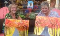 Robin and Carolynn with their autumn paintings