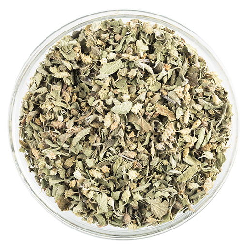 Bowl of Mexican oregano isolated on white.
