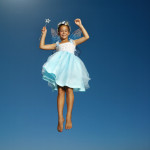 Young Girl Wearing Fairy Costume in Mid Air