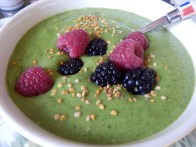 Green smoothie topped with berries