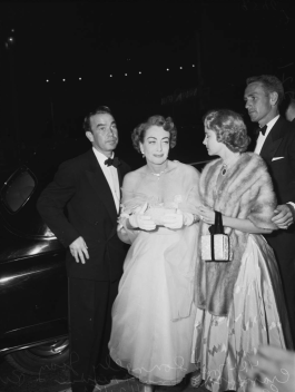 Joan Crawford arrive at Judy Garland's opening at the Los Angeles Philharmonic April 21, 1952