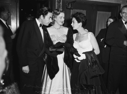 Leo Genn, Eleanor Parker, Jean Simmons arrive at Judy Garland's opening at the Los Angeles Philharmonic April 21, 1952