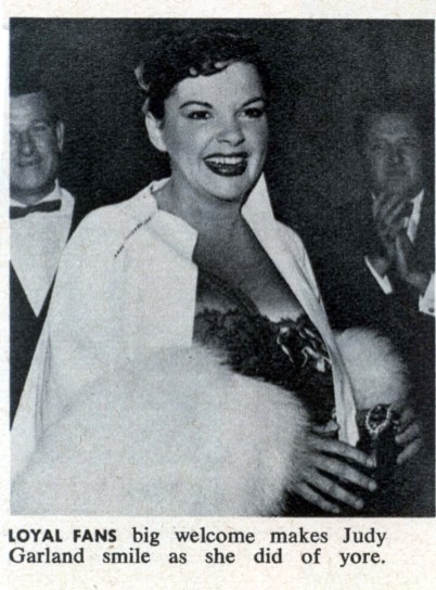 Judy Garland with Roger Edens in the background at Romanoff's after Garland's Los Angeles Philharmonic opening night April 21, 1952