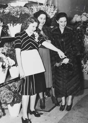 """Judy Garland and her two sisters in her flower shop, """"Judy Garland Flowers"""" early 1939"""