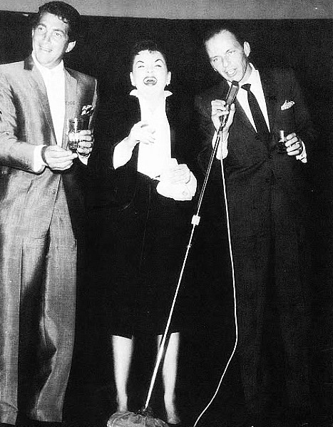 Judy Garland on stage at the Sands in Las Vegas, with Dean Martin and Frank Sinatra, October 14, 1958.