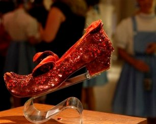 "Judy Garland's Arabian ruby slippers, one of five pairs believed designed by Adrian Greenberg of MGM studios and worn by Garland for test and wardrobe shots in the 1939 film ""The Wizard of Oz, "" are displayed at Saks Fifth Avenue in New York, Thursday, Sept. 4, 2008, part of an exhibit of ruby shoes created along the gemmed red slippers theme by well-known designers. The shoes, considered the most rare of all the ruby slippers used while making the film, are owned by Debbie Reynolds. (AP Photo/Kathy Willens)"